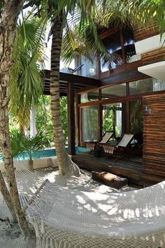 Beach house pool and hammocks