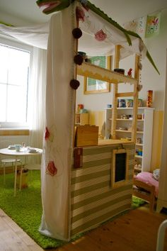 Playroom-I like the way the fabric is draped from the window to the middle structure (puppet theater?)