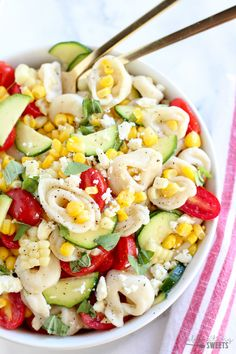 Corn, Tomato and Tortellini Pasta Salad - A summery pasta salad filled with tortellini, corn, tomatoes, zucchini and basil tossed with lemon vinaigrette.
