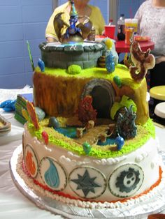 My son's 6th Birthday Cake...Skylanders Spyro's Adventure...All icing and edible...event Spro and the portal.  The only thing that you could not eat was the LED lights I put under the fondant portal top to make it light up like the actual game...