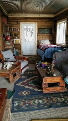 One room cabin living room with twin bed. Old oak walls with tin ceiling and concrete floors. Tiny House Cabin, Tiny House Design, Cabin Homes, Log Homes, Cozy House, One Room Cabins, Guest Cabin, Kabine, Cabin Interiors