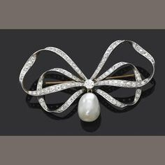An antique pearl and diamond bow brooch #DiamondBrooches