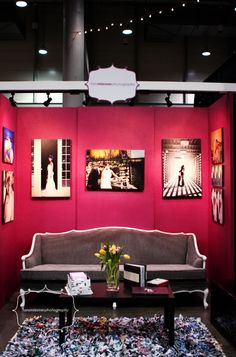 wedding booth expo idea...not a fan of the bright pink but I like the sofa and the detailed simplicity of it all.