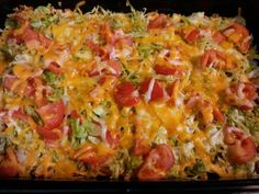 Taco Casserole:: 1 7oz. bag Nacho Cheese Doritos, crushed 1 lb. hamburger, browned 1 pkg. taco seasoning, mixed according to directions 1 (8 oz.) pkg. shredded Cheddar cheese 1 (8 oz.) pkg. shredded Mozzarella cheese Shredded Lettuce Sliced tomato  Layer ingredients in 9 x 13 pan as listed - crushed chips, meat and seasonings, 2/3 of cheese, lettuce, tomato, and remaining cheese. Bake at 350 degrees for 15 minutes