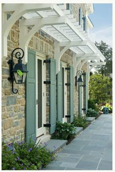 A way to add some shading to western or southern windows -- especially if vines are trained over them.