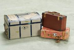Miniature doll trunk with old paper labels, two small candy container valises