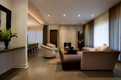 Large porcelain tiles for the living room - choose tiles with hint of brown for warmth
