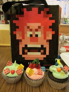 Use candy to decorate sheet cake and top with vanellope racer.  Oh boy, Mickey!: Wreck-it-Ralph Cupcakes!