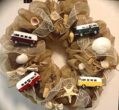 Year-round wreath for the Volkswagon Bus lover. I made this wreath as a gift, so I added many items which held meaning to the recipient, such as accents from the beach, pearls & lace, natural fibers,burlap and twine and deco mesh . STUNNING! Additional Keywords: VW, seashells, raffia, shells, wine corks, Troon