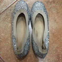 Stuart Weitzman Glittered Ballet Flats Stuart Weitzman silver glittered ballet flats. Slip on style. Worn a few times. Size 5 1/2. Stuart Weitzman Shoes Flats & Loafers