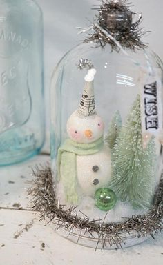 Antique Inspiration Collection 2017.... Embellished with Antique and Vintage Finds. Winter Wish Snow Globe...one on the cover of Better Homes & Gardens Holiday Crafts NOW This Vintage Inspired Snowman is hand sculpted and glimmers with an aged patina. He is joined by 2 Hand dyed