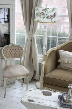 French furniture with a bit of shabby chic. Punch of modern in the design on the lamp shade
