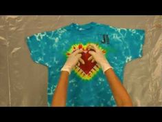 Part 5 in the series. This video shows how to tie and dye the centered rainbow heart pattern using Jacquards Tie Dye Kit, which includes Procion MX dyes. For more tutorials like this one from Jacquard, be sure to follow us on Facebook, at: http://www.facebook.com/JacquardProducts   http://jacquardproducts.com/tie-dye-kits.html http://jacquardpr...