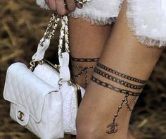 garter tattoo - I like the general idea of this, not the specific charm.