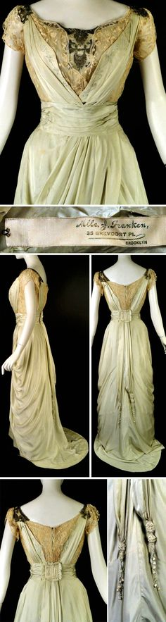 Evening gown, J. Franken, Brooklyn, ca. 1910. Pale celery green silk with ivory lace & silver beading. Boned lining in ivory silk. Bodice is ivory lace with silver bullion embroidery, bugle beads, & tiny sequins. Green silk suspenders fall in pleats from shoulders to center front & back, with crewel embroidery. Beaded appliqué panels on unlined shoulders. Right shoulder has piped bow w/dangle ball fringe. Pleated cummerbund w/buckle in back. Skirt w/large pleats in front. Vintage Martini