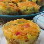 Omelet Breakfast Bites - 36 Tater tots, 1/2 c. diced ham, 1/2 c. diced tomatoes, 7 eggs, 1/4 c. milk, 1/4 c. cheese, salt/pepper--- Place 3 tater tots in bottom of each muffin tin (w/ or w/o liner). Bake at 400 for 10 min. Remove and press tots down to form a base using glass. Return to oven & bake 5 min. Top each w/ 1/2 T. each ham, tomato. Whisk eggs/milk and pour mixture into each tin until near top. Sprinkle w/ cheese. Bake at 350 for 20-25 min.