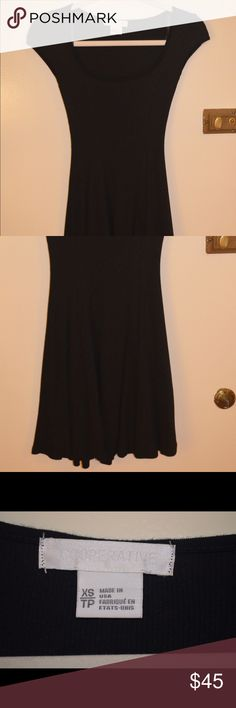 Black Cooperative Urban Outfitters Dress Worn once, but a little too short for someone my age! It goes to about the mid-thigh. Very cute and tight! Urban Outfitters Dresses Mini