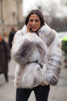 Capucine Safyurtlu in a belted grey fur coat + tan cable-knit sweater + black skinny jeans
