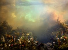 """Artist Kim Keever  creates these miniature worlds inside a 200-gallon fish tank, then projects various kinds of light through the water to create these dreamy large-scale photographs. Reminiscent of the Hudson River school and the Romantic """"painters of light,"""" these photographs have a wonderful sci-fi twist to them; a subtle yet eery artificiality."""