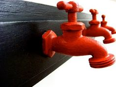 DIY ~ old faucets, paint them a hot red color and make a coat rack
