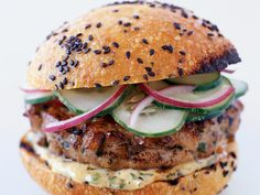 Thai Tuna Burgers with Ginger-Lemon Mayonnaise | These offbeat tuna burgers were loosely inspired by a Thai fried white fish patty called tod man pla. The Thai cucumber salad stands in for pickles. U...
