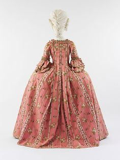 French Dress (Robe à la Française), ca. Pink ribbed silk with white linear silk vine motif and multicolored silk floral brocade with passementerie and scalloped fly fringe trim. Isabel Shults Fund, 2005 b). 18th Century Dress, 18th Century Costume, 18th Century Clothing, 18th Century Fashion, Robes Vintage, Vintage Dresses, Vintage Outfits, Vintage Fashion, Antique Clothing