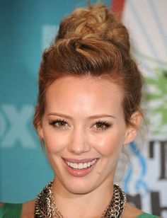 Top 10 Beachy Hairstyles | Daily Makeover  Hilary Duff's no-fuss updo is perfect whether you're hitting the waves or just soaking up some rays. Get the look by taking a three-inch section of hair and pinning it back on top of your head. Sweep up your length into a swirling bun and tie with an elastic band.
