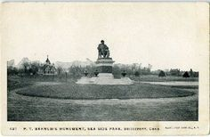 P.T. Barnum's statue with gorgeous home in background.  Bridgeport, CT