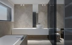 Could do a bath like this with a surround so that the toilet could hide behind it