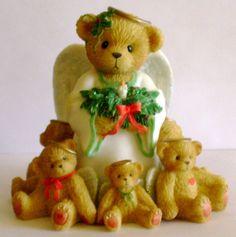 Cherished Teddies Caroline Winter Angels Figurine Cherished Teddies by Enesco. Caroline - # 864277. Like The Stars Of Heaven,I'll Light The Way Winter Angel With Six Angels Figurine. Material: Porcela