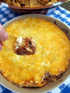 Taco Dip - Mix together and spread in bottom of baking dish: 1/2 pound browned ground beef, 1 can refried beans, 1 packet taco seasoning.  Spread 8 oz. sour cream over mixture. Top with 2 cups shredded cheese. Bake at 350 for 25 - 30 minutes or until cheese is bubbly.