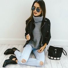 black jacket, grey knitted turtle neck, light wash ripped jeans, black boots