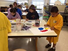 First graders drew fish and began painting with the primary colors. We listened to the sounds of the ocean as we worked.