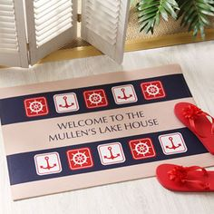 "This ""Ahoy!"" Personalized Nautical Doormat has a Sailing Theme that would be PERFECT for a Summer or Lake House! LOVE the anchors and colors and it's only $22.95! You can personalize it with any 2 lines you'd like in the middle - only at PMall! #LakeHouse #Sailor #Nautical #anchor"