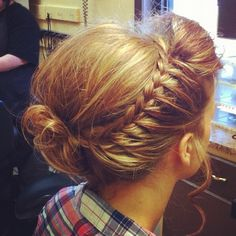 Messy bun, one-sided French braid.