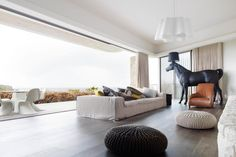Unreal living room, but check out that horse sculpture lamp - definitely a conversation starter