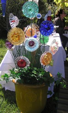Thrift store glass plates into garden flowers. Great idea!