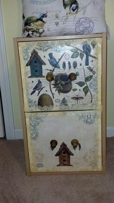 Modpodged scrapbook paper and lace to file cabinet. Added knobs from Hobby Lobby.  Nancy