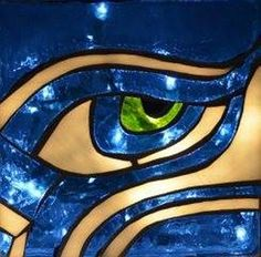 "This piece is a great way to show your 12th man support for our beloved Seahawks!  Strips of green and blue glass on the sides highlight this Seahawk eye.  This piece displays equally well with or without the light turned on (light included). Created with blue, white and green stained glass and a gray, concrete-colored grout. The block is a DecoBlock (new). This is a custom piece and will be made when ordered. Delivery will be 1-2 weeks.  The glass block measures 8""x8"" and 3"" deep. The block…"