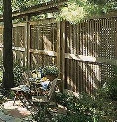 You could add some sort of arbor to the top of an existing fence. be sure to use additional support for the extra weight load.  Plant at will!