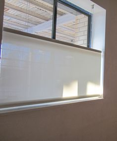 Bottom Up Lutron Motorized Solar Shade Covers The Small Windows In A  Basement. Interior Design