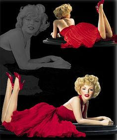 """Marilyn Monroe Franklin Mint No.14 Forever Marilyn,  PORCELAIN 16"""" long laying on a polished wooden base; Dressed in the red chiffon dress made famous by photographer Milton H. Greene; released 2002; original price $195.Z"""