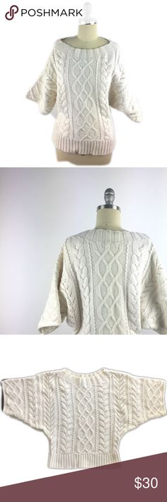 """Express Short Sleeve Cable Knit Sweater M Thick cable knit dolman sweater by Express has a short sleeve and waist length. Boat neckline. Heavy, cotton blend fabric. I always get compliments on this! 28"""" underarm to underarm, 24"""" length. Excellent preowned condition. A010 Express Sweaters Crew & Scoop Necks"""