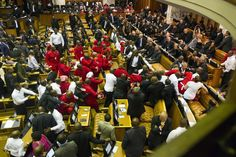 Week of Feb 7-13, 2015 Members of Julius Malema's Economic Freedom Fighters, in red, clash with security officials after being ordered out of the chamber during South African President Jacob Zuma's State of the Nation address in Cape Town. RODGER BOSCH/PRESS POOL
