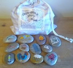 Once Upon A Story Stone... are a set of 12 double sided handdrawn stones. Each stone is adorned by a hand drawn image of a place, person, object or method of transport. The reverse of each stone is an opposite or something which relates to the other. Set 1 comes with the following images. Sun ~Rain cloud Whale ~ Fish  Submarine ~ Rocket  Fire engine ~ Campfire  Robot ~ Alien  Chicken ~ Cockerell  Carrot ~ Candy cane  Boy ~ Girl  Treasure map ~ Crown  Igloo ~ Mud hut  House ~ Flats  Postbox…