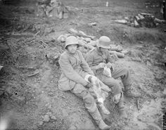 Two German soldiers dressing their wounds at the make shift aid stantion at Zillebeke, during the Battle of the Menin Road Ridge/20 September 1917