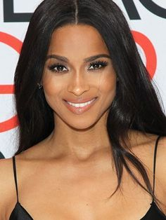 Ciara middle-part effortless waves with brown eyeliner and glossy lips | allure.com