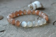 Check out this item in my Etsy shop https://www.etsy.com/listing/478464387/fertility-peach-moonstone-and-moonstone