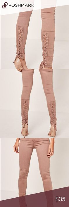 Missguided Rose Pink Lace up Skinny Jeans size 00 Pre-owned.  Excellent condition.  Size 00. Beautiful lace up details. Urban Outfitters and Tobi vibe! Missguided Pants Skinny
