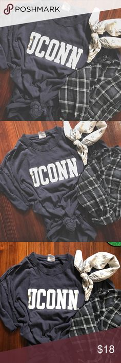 2PP VINTAGE // Dark Blue UCONN campus t-shirt Faded just perfectly! The lettering has slight cracking also. But these both make this t-shirt that much more vintage! Super comfortable, relaxed! overall awesome t-shirt. Tag is size x-large. —- #2prettypistols #uconn #campus #college #university #vintage #vtg Vintage Shirts Tees - Short Sleeve